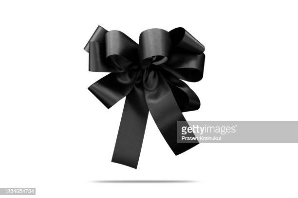 style black silk ribbon bow isolated on the white background - mourning stock pictures, royalty-free photos & images