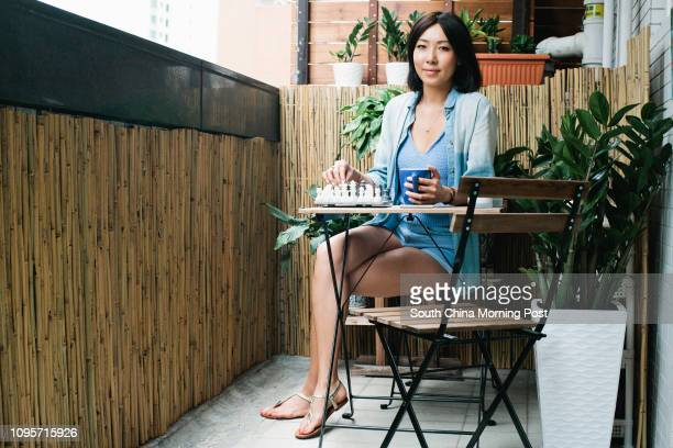 Style Confessions of Founder of Gourmet Skin Bar Wendy Thian In this picture Wendy is wearing a denim shirt from Anthropologie a Zara deep V shirt...