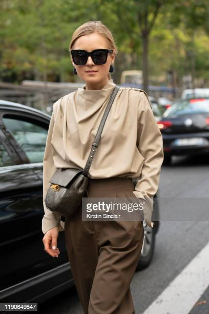 Style consultant Ana Borisovna wears Celine sunglasses, Zara shirt and trousers, Mango bag on September 27, 2019 in Paris, France.