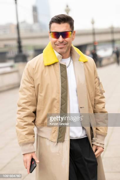 Style Director Alex Badia wears Giorgio Armani sunglasses Helmut Lang cropped jacket during London Fashion Week Men's January 2019 on January 07 2019...