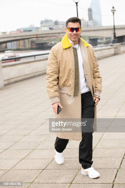 Style Director Alex Badia wears Giorgio Armani sunglasses Helmut Lang cropped jacket Reebok trainers during London Fashion Week Men's January 2019 on...
