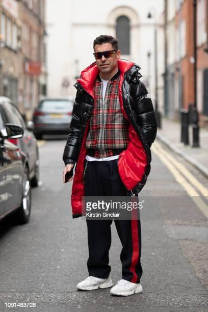 Style Director Alex Badia wears Giorgio Armani sunglasses Maison Valentino down jacket Dries Van Noten jacket during London Fashion Week Men's...