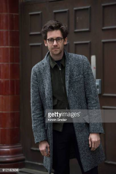 Style Director at Esquire magazine Charlie Teasdale wears a Brunello Cucinelli coat Kent and Curwen jacket Oliver Peoples glasses day 3 of London...