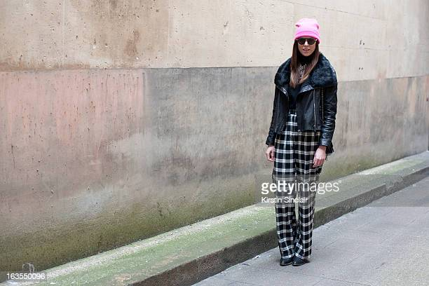 Style editor at Ladygunn magazine and PR Stacy Jean wears Asos trousers Vince sweater Chanel bag Rigards sunglasses June jacket a Top Shop hat and...