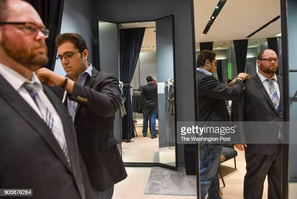 Style guide Kiavash Asghari center measures customer Bobby Bartlett of Germantown Md on a new suit purchase at Indochino in Tyson's Galleria on...
