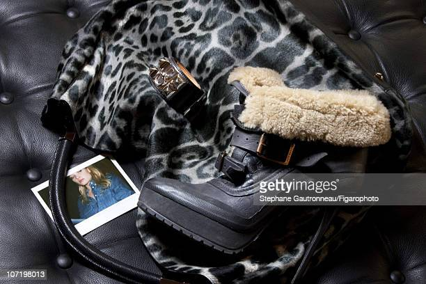 Style inspirations of actress Melanie Thierry photographed for Madame Figaro on September 29, 2010. Published image. Figaro ID: 098750-003. Bag by...