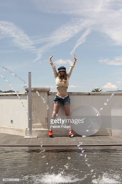 Styled by Samantha Hughes hair by Alexandre of Paris and makeup by Dr Hauschka Short crochet sweater by HM denim shorts by Wrangler vintage cap rope...