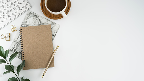 Styled stock photography white office desk table with blank notebook, computer, supplies and coffee cup. Top view with copy space. Flat lay. 929898258