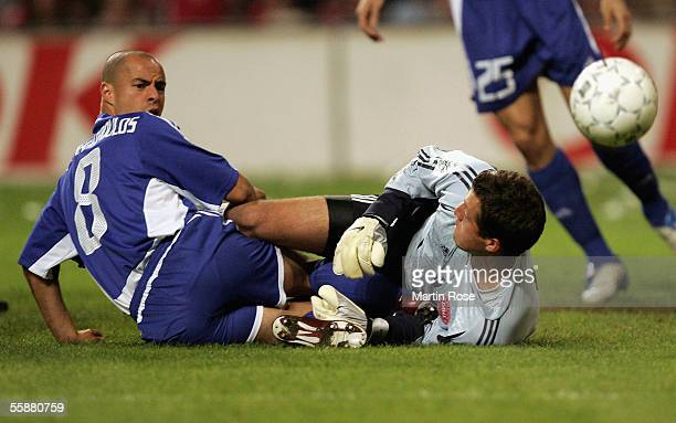 Stylianos Giannakopoulus of Greece challenges goalkeeper Thomas Soerensen during the FIFA World Cup 2006 Group 2 Qualifier match between Denmark and...