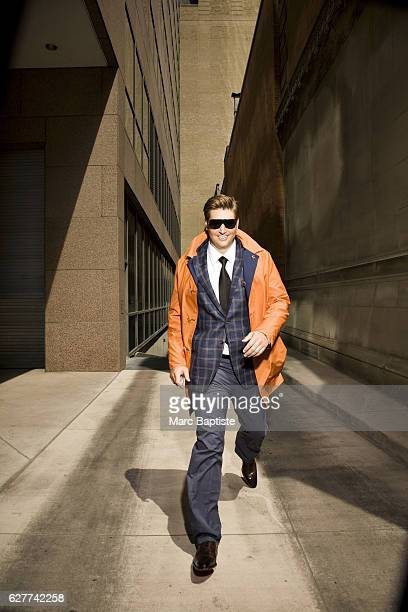 April Francis, Grooming: Sara Salatanovitz. Overcoat by Kiton, sport coat by Oxxford, shirt by Zegna, tie by Charvet, pants by Kiton, sunglasses by...