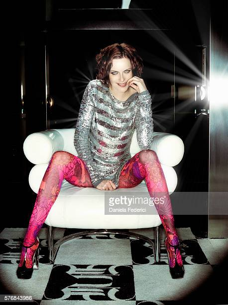 Styling by Cheryl Konteh hair by Felix Fischer and makeup by Christina Reyna Silver sequined cottonmix dress by MaxMara pink flower Lycra tights by...