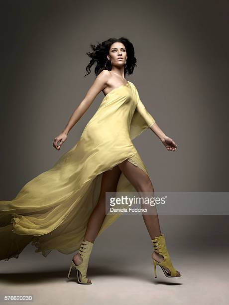 Styling by Garth Condit makeup by Lisa Garner and hair by Charles Baker Strahan Oneshoulder chiffon dress in lemon and Cluny threequarter boot in...