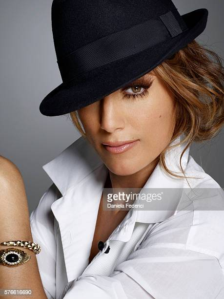 Styling by Ye Young Kim hair by Clyde Haygood and makeup by Melissa Rogers Blouse by Giorgio Armani hat by Brooks Brothers and bracelet by Roberto...