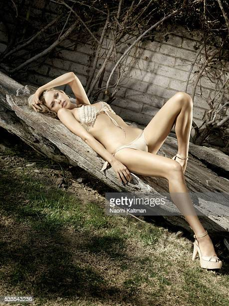 Erin TUron Hair Jonathan Hanousek Makeup Justin Henry Prop Styiling Antonio Ballatore Bikini by Rosa Cha shoes by Fendi earrings and ring by David...