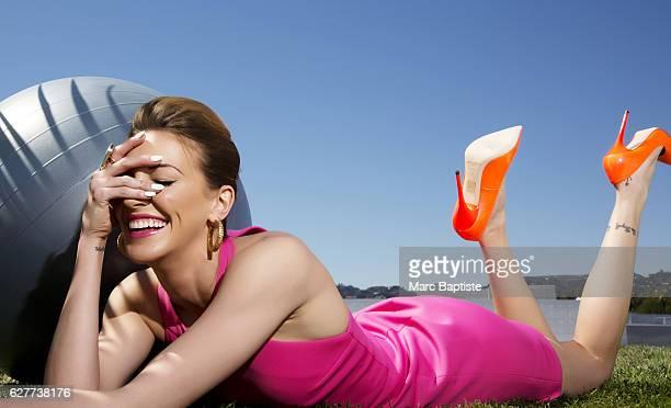 Holly Copeland; Makeup: Ashleigh Louer; Hair: Lea Journo. Dress by Bec & Bridge. Shoes by Jimmy Choo. Earrings by Isharya.