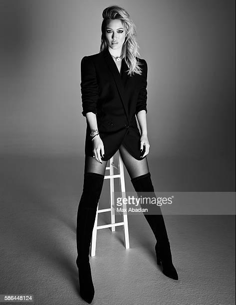 Juliana Schiavinatto; Hair: Justin German; Makeup: Sabrina Rinaldi; Manicure: Melissa Forrest. Blazer by Stella McCartney. Boots by Stuart Weitzman....