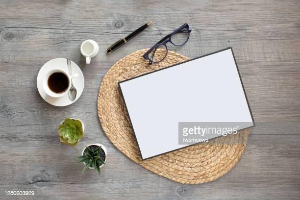 stylised flat lay coffee table top still life. - couchtisch stock-fotos und bilder