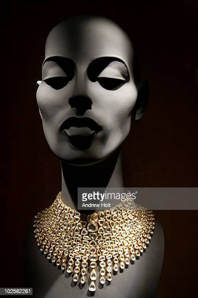 stylised mannequin and diamond necklace - necklace stock pictures, royalty-free photos & images