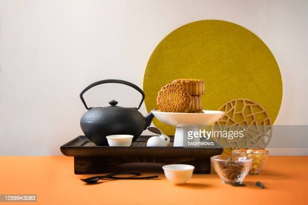 stylised mid autumn festival food and drink still life. - moon cake stock pictures, royalty-free photos & images