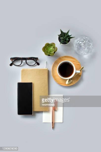 stylised modern flat lay domestic working table top still life. - schreibtisch stock-fotos und bilder