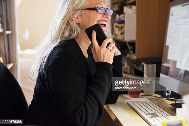 stylish 50+ woman working from home. - science and technology stock pictures, royalty-free photos & images