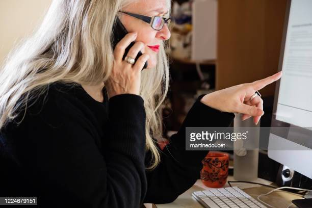 "stylish 50+ woman working from home. - ""martine doucet"" or martinedoucet stock pictures, royalty-free photos & images"