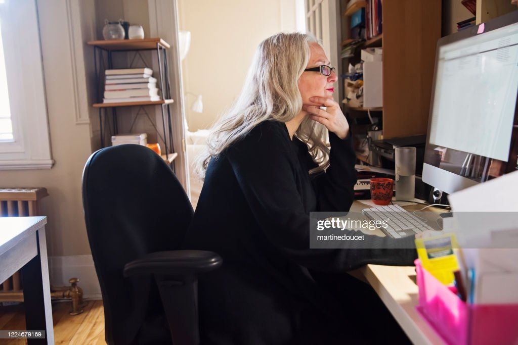Stylish 50+ woman working from home. : Stock Photo