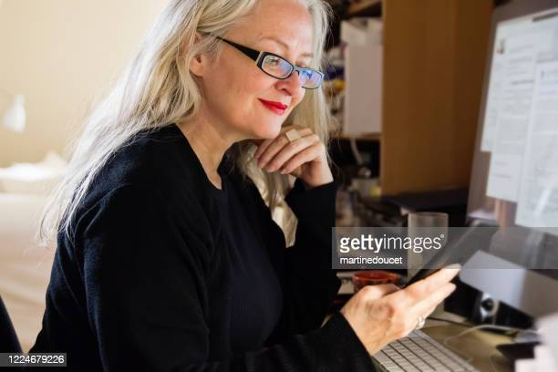 """stylish 50+ woman working from home. - """"martine doucet"""" or martinedoucet stock pictures, royalty-free photos & images"""