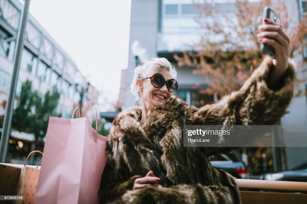 Stylish and Quirky Senior Woman Takes Selfie : Stock Photo