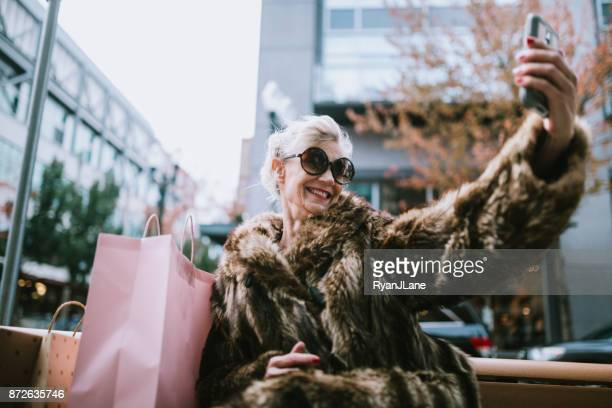 stylish and quirky senior woman takes selfie - fashionable stock pictures, royalty-free photos & images