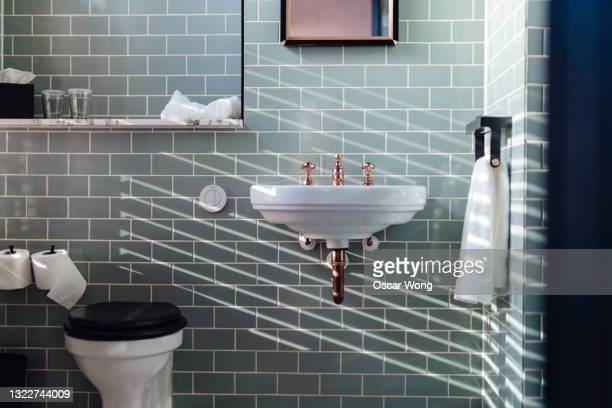 a stylish bathroom interior - brightly lit stock pictures, royalty-free photos & images