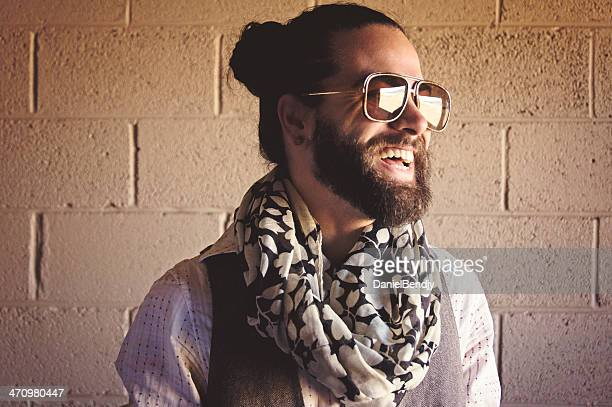 stylish bearded man laughing - man bun stock pictures, royalty-free photos & images