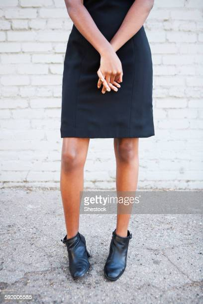 stylish black woman wearing dress and boots - black boot stock pictures, royalty-free photos & images