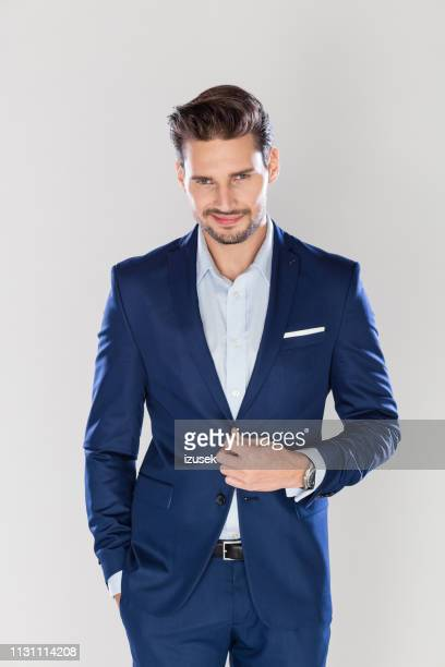 stylish business man on gray background - jacket stock pictures, royalty-free photos & images