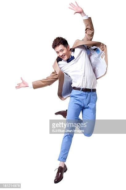 stylish businessman jumping with excitement - 男性一人 ストックフォトと画像