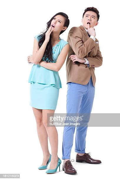 Stylish businesspeople looking puzzled and surprised