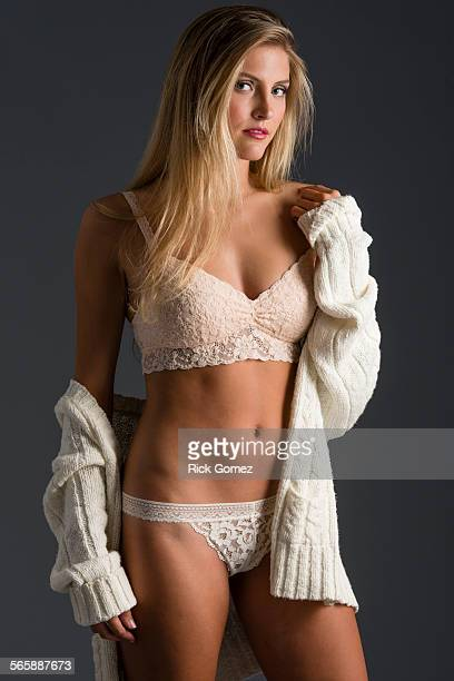 Stylish Caucasian woman wearing lingerie and sweater
