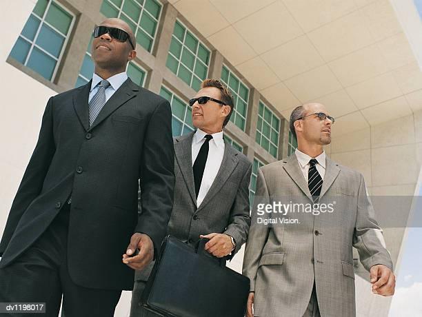 stylish confident businessmen wearing suits - ミッドアダルト ストックフォトと画像