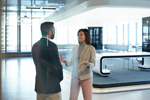 Stylish co-workers having discussion in office building - gettyimageskorea