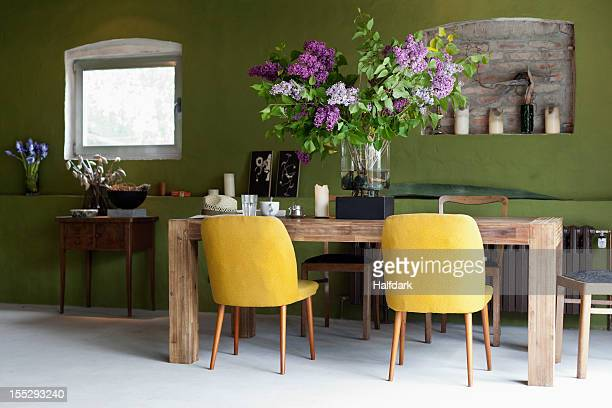 a stylish dining room - dining room stock photos and pictures
