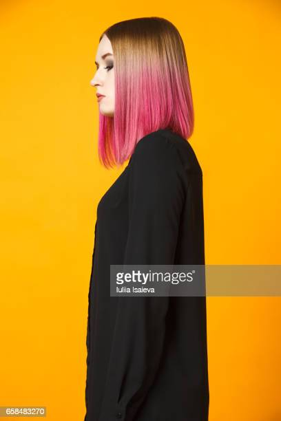 Stylish female isolated on orange