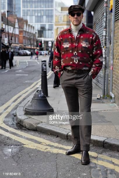 Stylish gentleman attends the London Fashion Week Men's Day One Street Style.