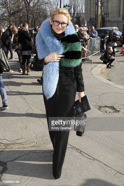 A stylish guest arrives at the Chanel fashion show for Paris Fashion Week Fall/Winter 2012 on March 8 2011 in Paris France