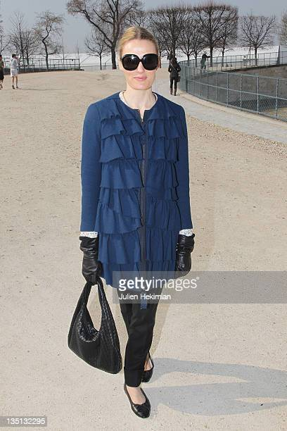 Stylish guest arrives at the Viktor Rolf fashion show with a Philip Lim coat Chanel shoes and a Stella Mc Cartney pant during the Paris Fashion Week...