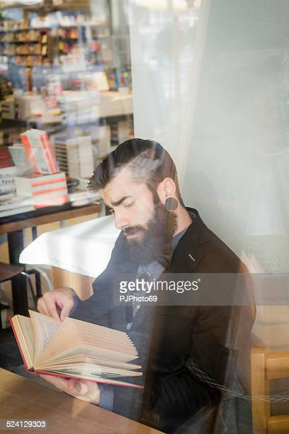 stylish hipster in a book-cafe - pjphoto69 stock pictures, royalty-free photos & images