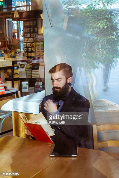 Stylish Hipster in a book-cafe