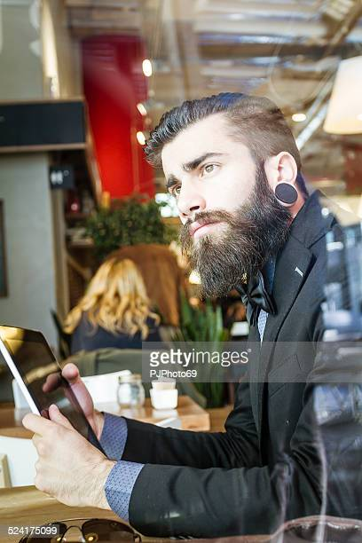 stylish hipster in a coffee shop - pjphoto69 stock pictures, royalty-free photos & images