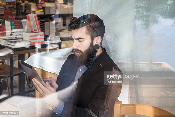 Stylish Hipster in a coffee shop