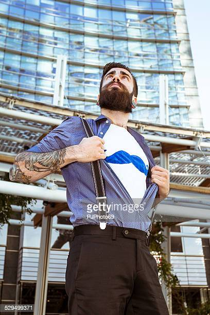 stylish hipster showing mustaches on t-shirt - pjphoto69 stock pictures, royalty-free photos & images