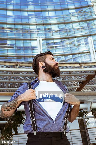 stylish hipster showing mustaches on t-shirt - pjphoto69 stockfoto's en -beelden